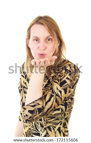 Elegant woman blowing kisses to her valentine - stock photo