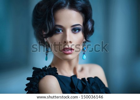 Elegant woman in black cocktail dress - stock photo