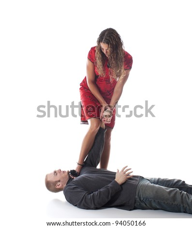 Elegant woman in high heels using Judo to overpower a mugger   - stock photo