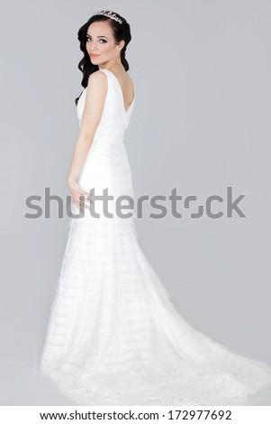 elegant woman in white wedding dress - stock photo
