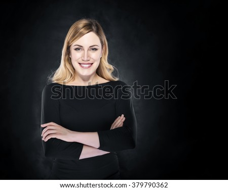 Elegant woman over dark background fashion photo. - stock photo