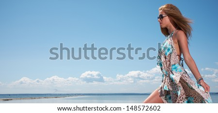 Elegant  woman wear dress in motorboat - stock photo