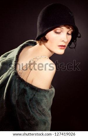 elegant woman wearing  felt hat in retro style - stock photo