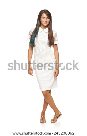 Elegant woman wearing white dress standing relaxed in full length over white background - stock photo