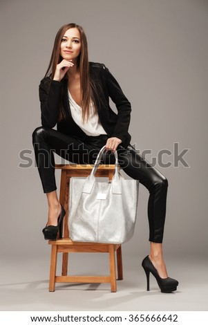 Elegant woman with a silver fashion bag