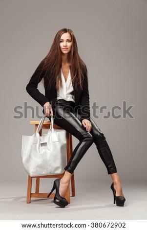 Elegant woman with a silver fashion bag  - stock photo