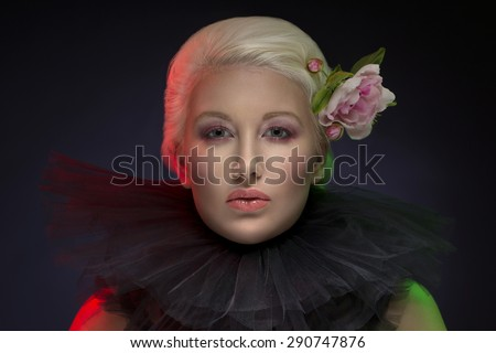 Elegant woman with flowers in her hair - stock photo