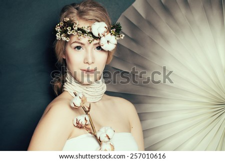 Elegant woman with healthy skin on fashion background - stock photo