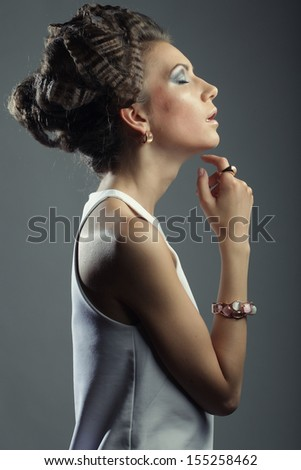 Elegant woman with luxury make up and hairstyle. Studio shot. - stock photo