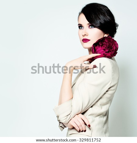 Elegant Woman with Makeup and Brunette Hair - stock photo