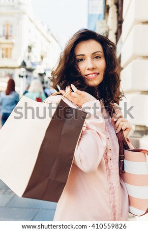 Elegant woman with shopping bag in the city - stock photo