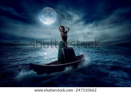 Elegant woman with suitcase standing on boat in middle ocean after storm drifting away with moonlight sky clouds background. Conceptual landscape screen saver. Elements of this image furnished by NASA - stock photo