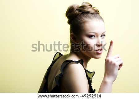 Elegant young blond girl. Profile view - stock photo