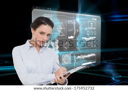 Elegant young businesswoman with clipboard against doorway on technological black background