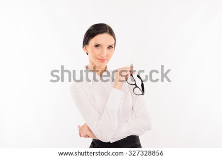 Elegant young businesswoman with glasses - stock photo