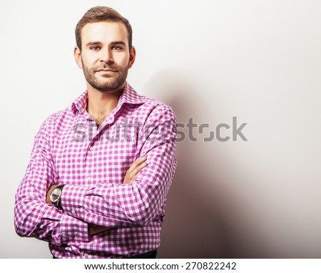 Elegant young handsome man in bright colorful shirt. Studio fashion portrait.  - stock photo