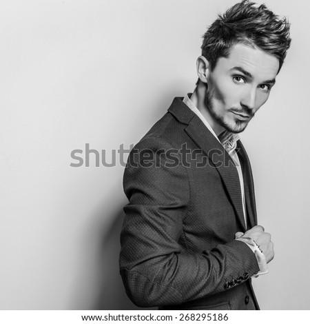 Elegant young handsome man in costume. Black-white studio fashion portrait.  - stock photo