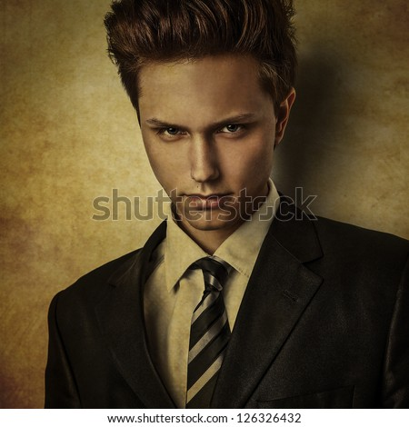 Elegant young handsome man in costume..Grunge style digital painted image portrait of men face.
