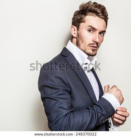 Elegant young handsome man in costume. Studio fashion portrait. - stock photo