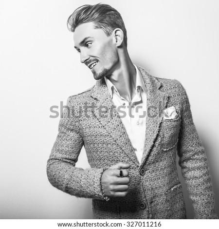 Elegant young handsome man in stylish costume. Black-white studio fashion portrait.  - stock photo