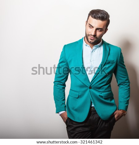 Elegant young handsome man in stylish turquoise jacket. Studio fashion portrait.  - stock photo
