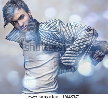 Elegant young handsome man..Multicolored digital painted image portrait of men face.