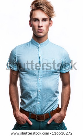 Elegant young handsome man. Studio fashion portrait on bright background. - stock photo