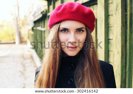 Elegant young Parisian woman outdoors. Beautiful charming girl in red beret. French Style - stock photo