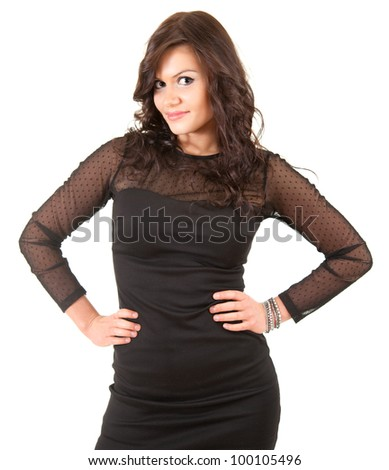 elegant young woman in black dress with hands on waist, white background