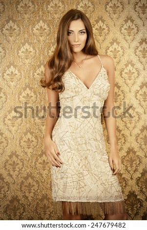 Elegant young woman in  evening dress posing in vintage interior. Fashion shot. - stock photo