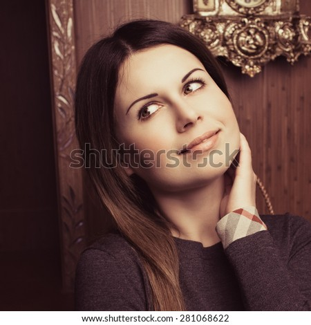 Elegant young woman posing in vintage interior. Fashion shot. Vogue style. - stock photo