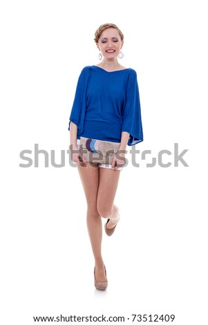 Elegant young woman with purse on white background expressing positivity by laughing - stock photo