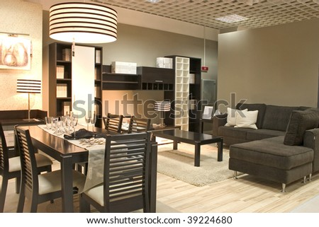 Elegnat dining room black colors. Coffe table with sofa and dining table with glasses. - stock photo