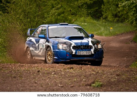 "ELEKTRENAI, LITHUANIA - MAY 21: Antanas Simelis drives an Ataka Racing team Subaru Impreza car during ""Vilniaus ralis 2011"", on May 21, 2011 in Eleketrenai, Lithuania"