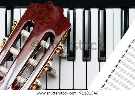 element of the guitar on the piano - stock photo