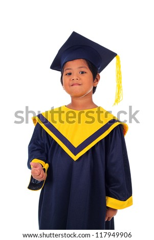 Elementary boy proudly wearing his graduation cap and gown isolated on white