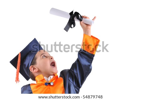 Elementary boy wearing graduation cap and gown holding his diploma - stock photo