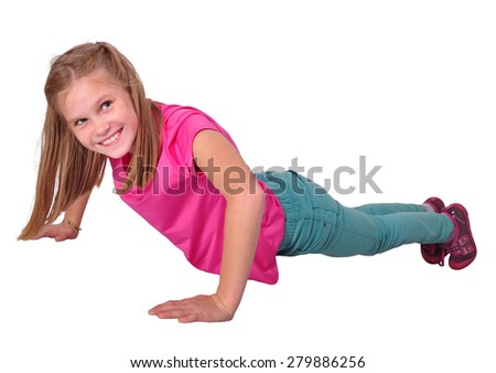 Elementary child working out  exercises in gym class. Studio short. Isolated over white background. - stock photo