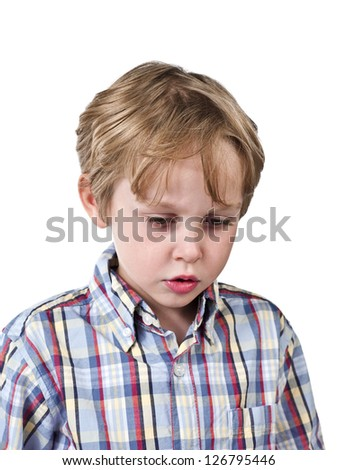 Elementary kid looking down against white background.