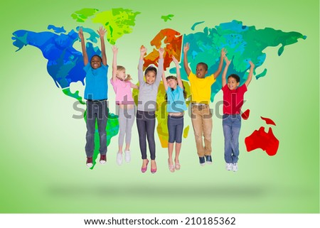 Elementary pupils jumping against green vignette with world map - stock photo