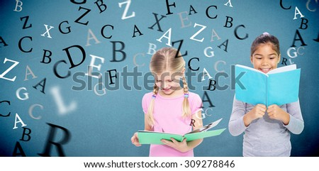 Elementary pupils reading against blue background - stock photo