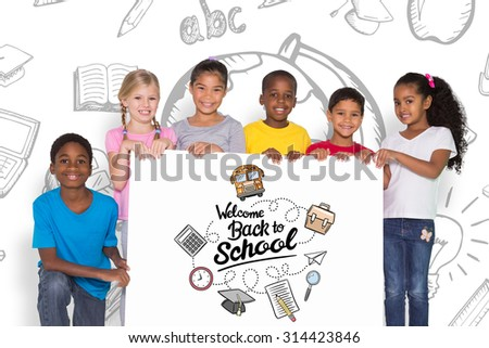 Elementary pupils showing card against back to school - stock photo