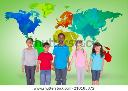 Elementary pupils smiling against green vignette with world map - stock photo