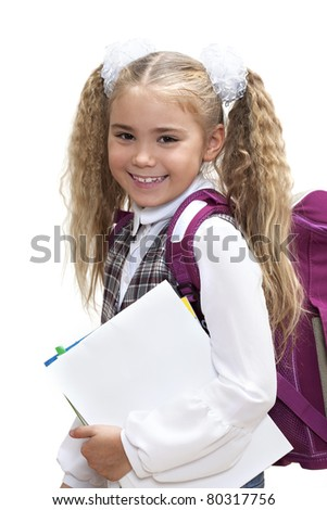 Elementary school age girl on a white background - stock photo