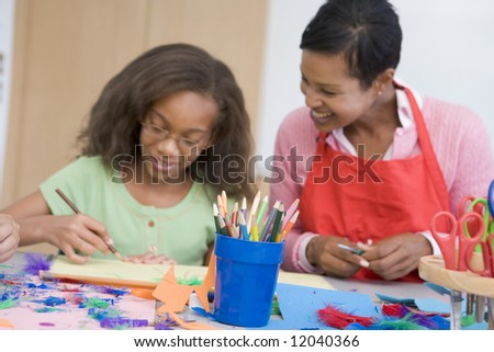 Elementary school art class with teacher - stock photo