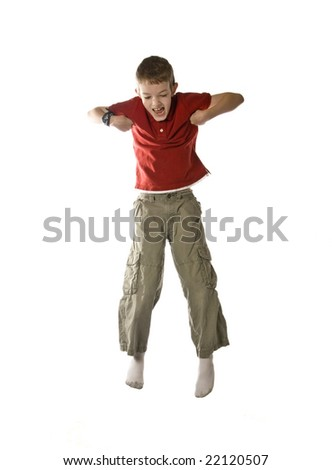 elementary school boy jumping, isolated over white - stock photo
