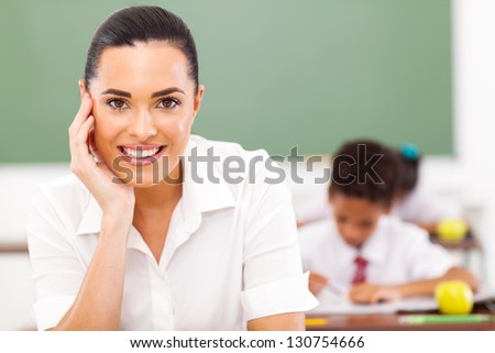 elementary school educator siting in classroom