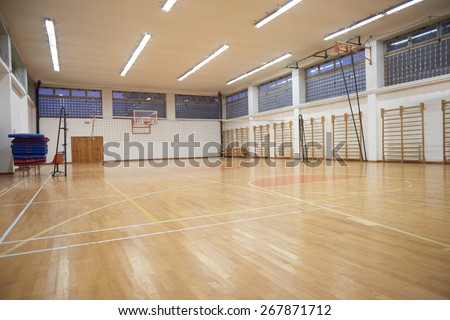 elementary school gym indoor with volleyball net - stock photo