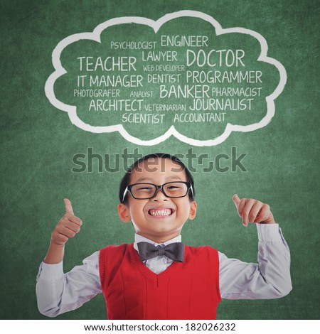 Elementary school student with proud expression showing his ideals over his head - stock photo