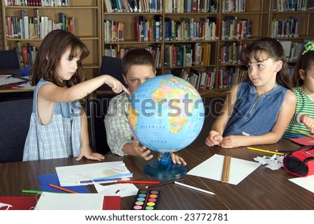 Elementary school students studying - stock photo